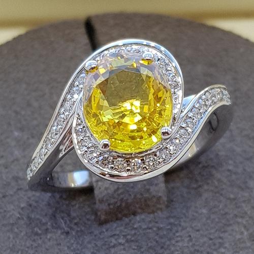 Yellow sapphire and diamond platinum cocktail ring, swirl design